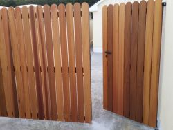 Cedar wood clad gate on galvanized steel frame
